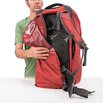 dc182bee1c0f Red luggage back with stowaway hipbelt and harness to turn into backpack.