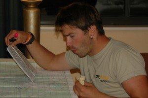 Navigator Tom Zidek plotting at 11:30pm