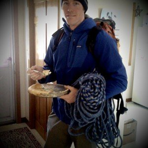 Pre-Climb Snack, Peter Doucette grabs a half of a chicken pot pie to feed his obsession