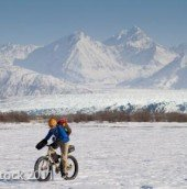 Anthony on his Surly Pugsley on thin snow over thick river ice.