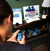 A board member photographs her product (the shoe on the left!) in Senator Ron Wyden of Oregon's office