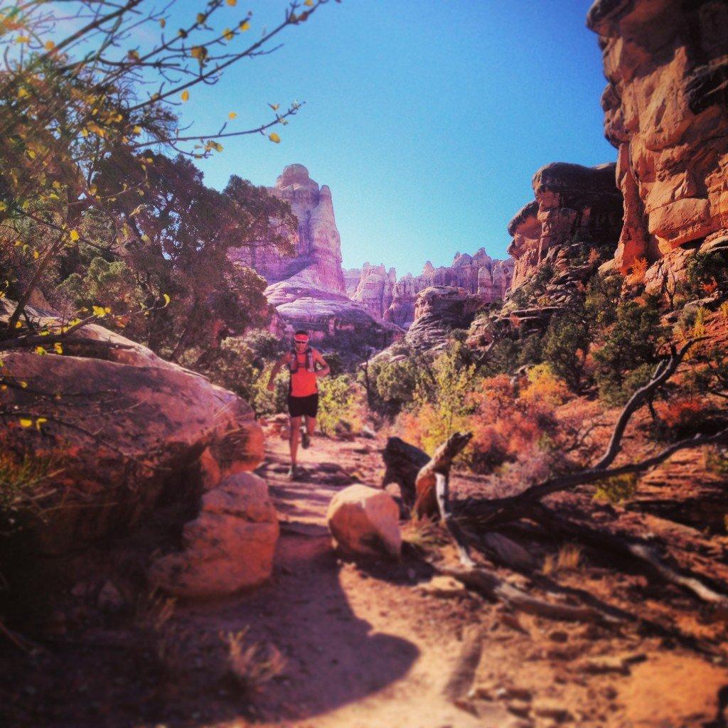Erich Owen running through the canyonlands