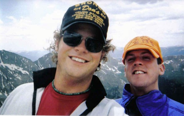 "Don (left) and me on top of 14,005' Huron Peak in 2002. We are celebrating our Tennessee heritage in ""special hats"" before cutting loose and charging down the mountain."