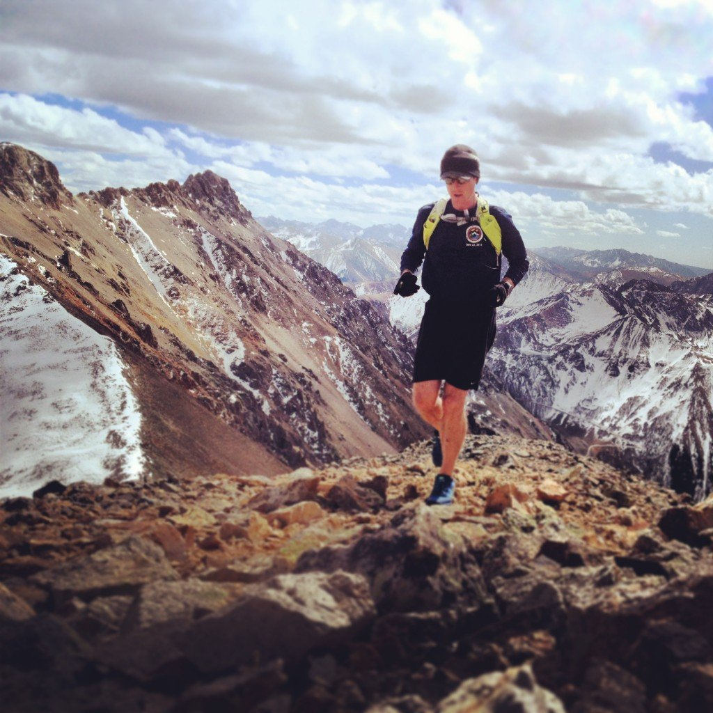 Ben Clark running the last steps to the summit of 13,432' Oscar mountain outside Ophir, Co.