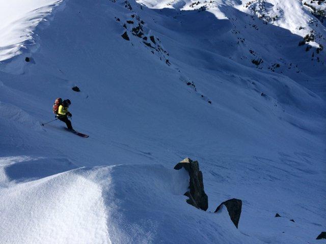 Caroline skis down from Profanity Col, Sentry Lodge.