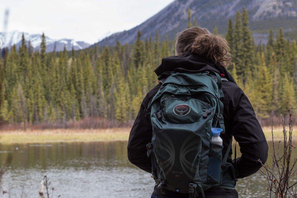 Dian and her Osprey Packs Sirrus 24 near Johnson Lake, Banff.