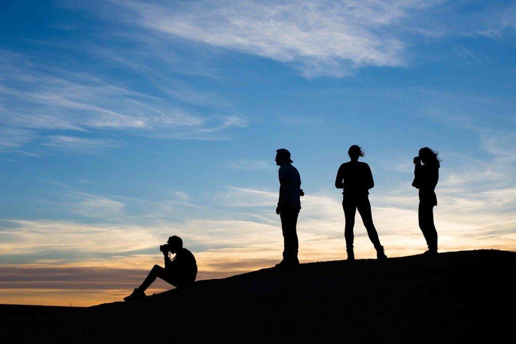 Robbie, Ciaran, Dian, Lara watching the sunset in Dinosaur Provincial Park