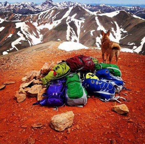 Hiking crew of 9 from Osprey Packs climbed 14ers Redcloud & Sunshine -- the summit cairn wasn't big enough so we added some of our backpacks. photo via Osprey's Mychal McCormick.