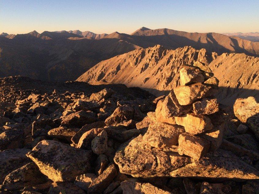The last rays of light on the summit ridge of La Plata peak, entering the first night.