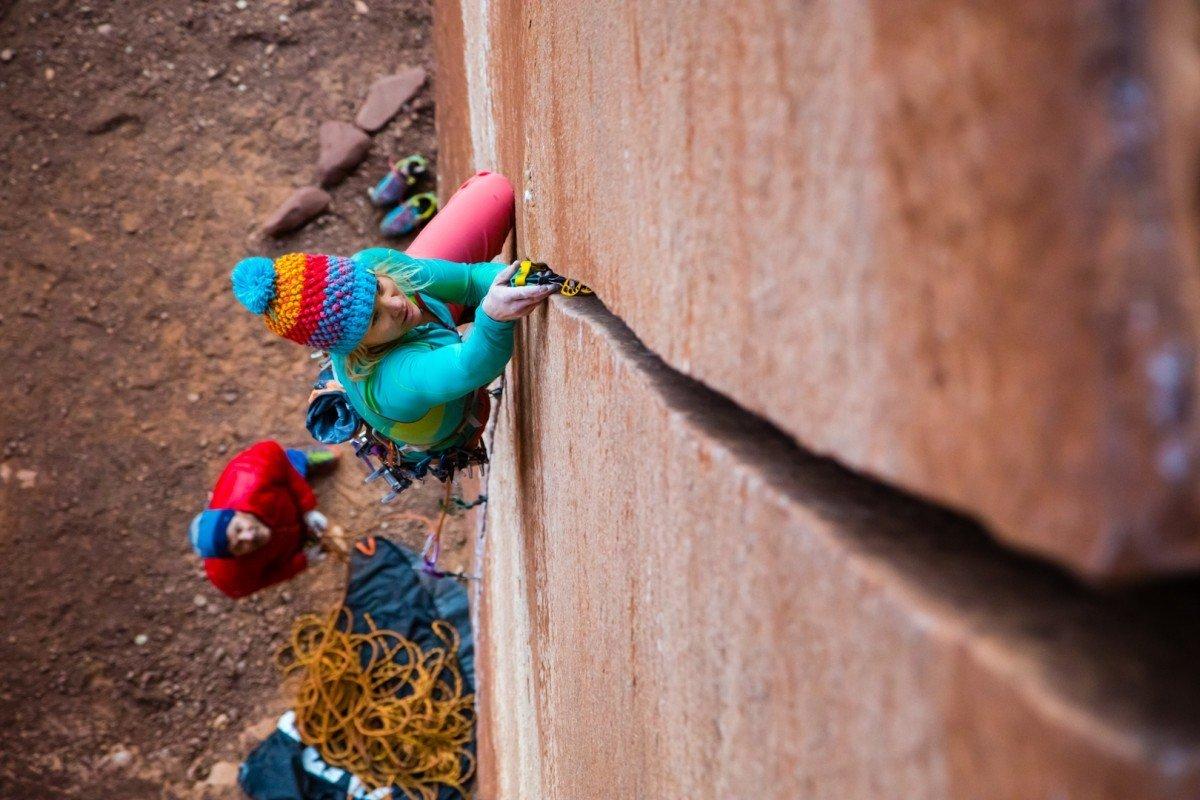 Anna Pfaff takes a run up S Crack 5.10 Escalante Canyon, CO