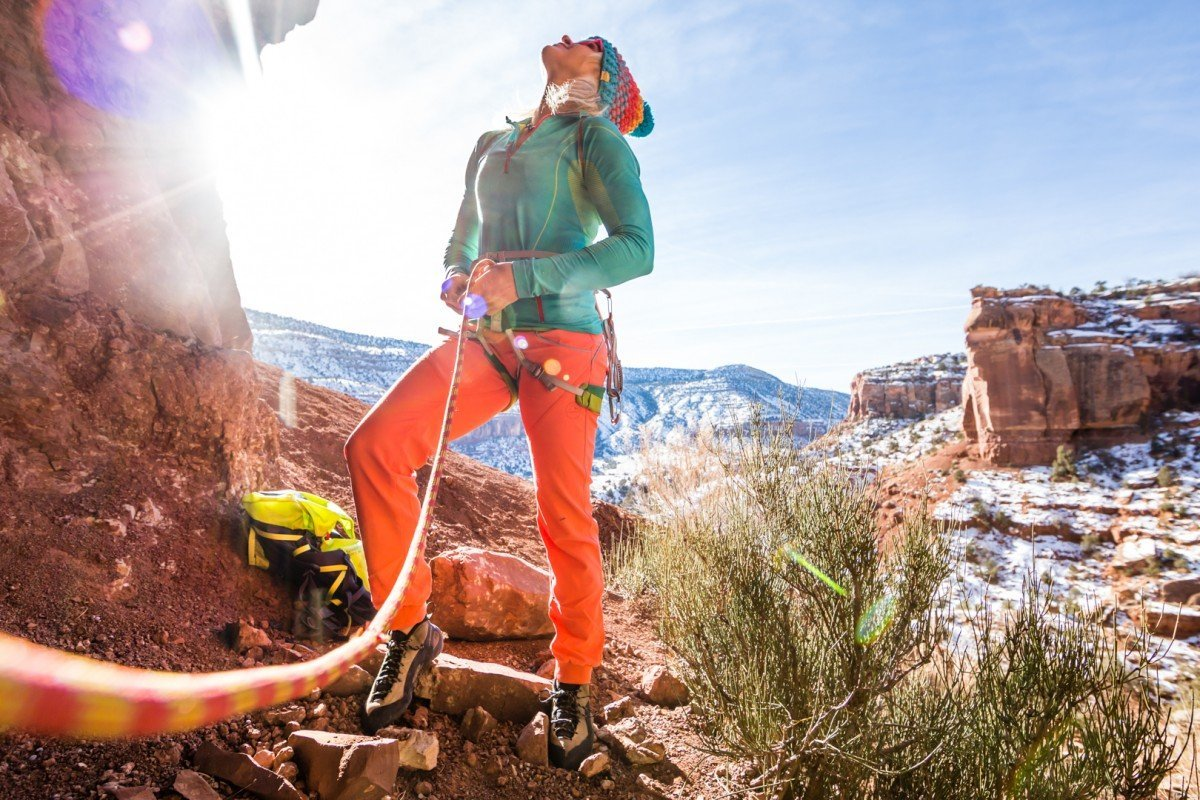 Anna Pfaff ties in to take a run up Passion for Pumping a 5.11+ in Escalante Canyon, CO