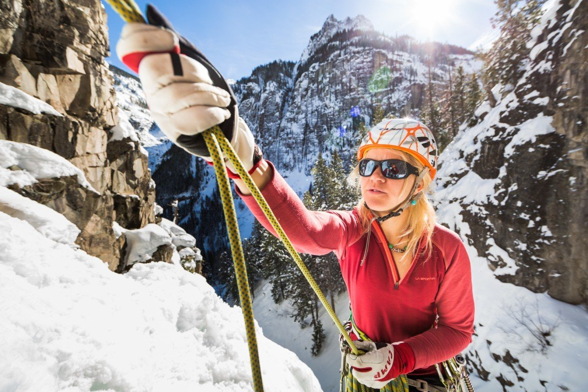 anna pfaff rigs an anchor at the top of Senator Gulch - WI4 - Ouray, CO