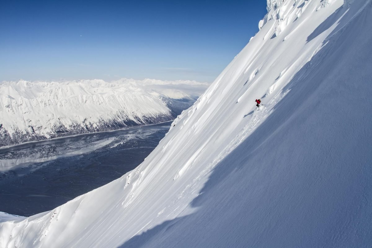 Cody Arnold backcountry skiing above Turnagain Arm, Kenai Mountains, Alaska. Spring. MR